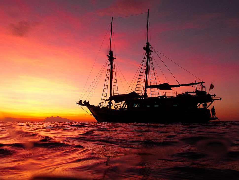 A Komodo Liveaboard Scuba Diving Boat at Sunset