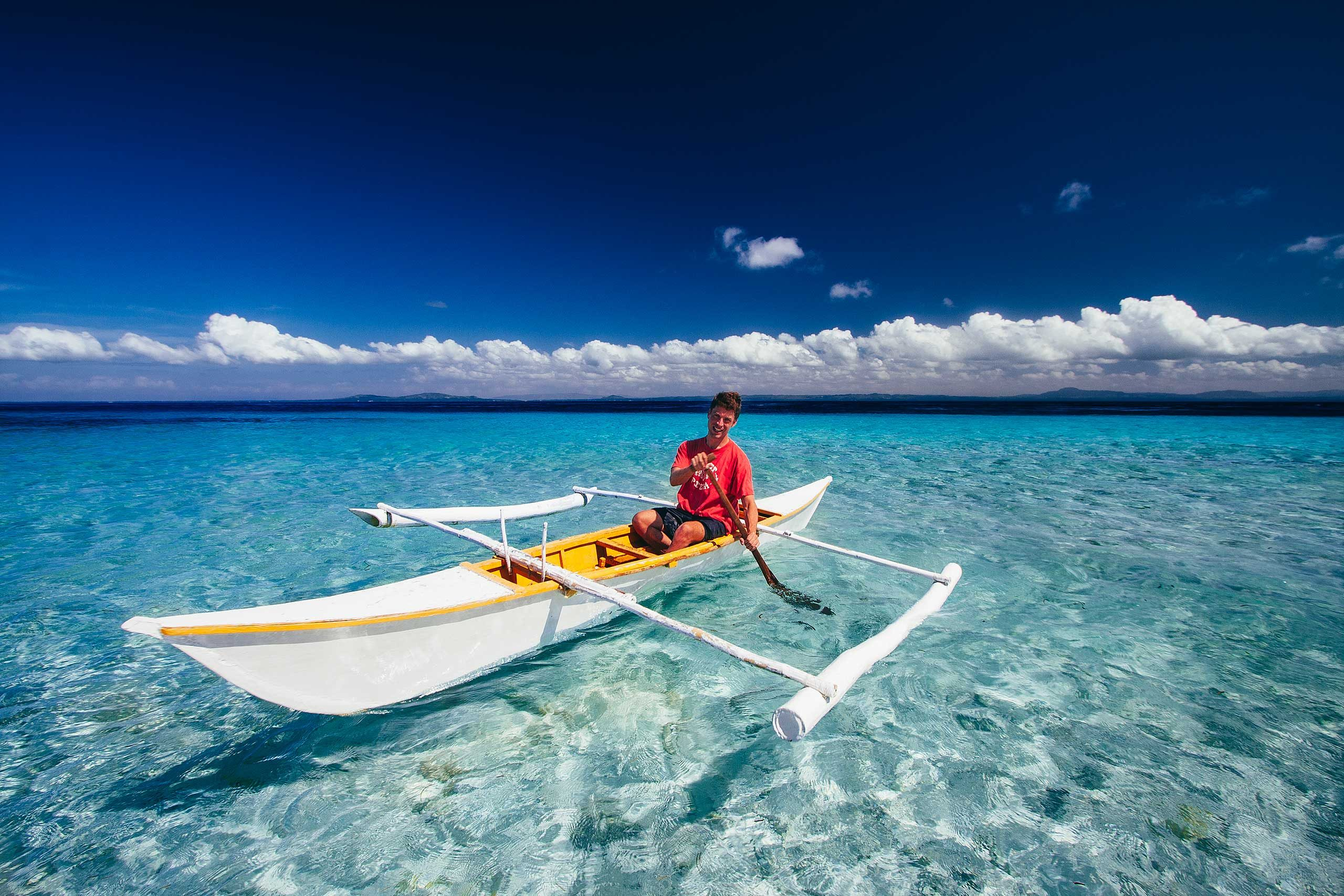 Paddling an outrigger 'bangka' sea kayak on Pamilacan Island | Photo by Mang Fe